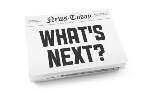 "A stack of newspapers with headline ""What's Next"". Isolated on white."